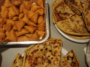 Clockwise from top left: samosas; parathas, more parathas - INDIA
