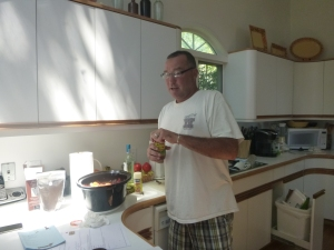 Vinny in the kitchen (this may be him making the ceviche and not the chicken, but nevermind)