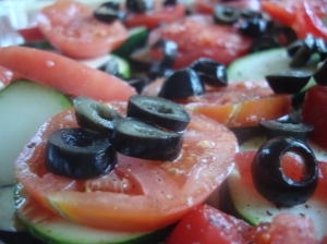 The olives provide proper punctuation to the vegetables.