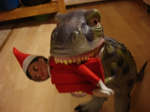 T-Rex takes a shine to our elf!
