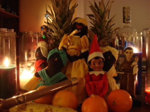 Lucia celebrating sincretization of religions with some of her Cuban friends...Elegguá (as Saint Anthony), Oshún, and Yemayá. Aché!