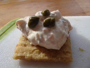 On a cracker, dressed up with some capers...