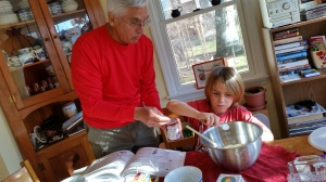 The little man impressed his grandfather by leveling off the measured ingredients