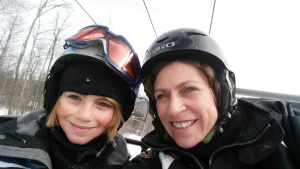 Yes, it is many degrees below zero and we are on a ski lift...am I smiling or grimacing?